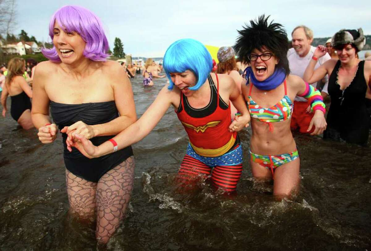 Participants brave the 49-degree Lake Washington water during the annual Polar Bear Plunge at Matthews Beach in Seattle on Sunday, January 1, 2011. The 10th annual New Year tradition saw one of its largest turnouts as people waded, ran and dove into the cold water.