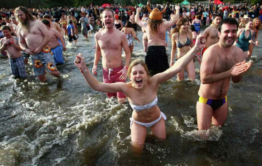 Participants brave the 49-degree Lake Washington water during the annual Polar Bear Plunge at Matthews Beach in Seattle on Sunday. Photo: JOSHUA TRUJILLO / SEATTLEPI.COM