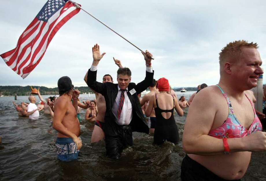 Participants brave the 49-degree Lake Washington water during the 10th annual Polar Bear Plunge at Matthews Beach in Seattle. Photo: JOSHUA TRUJILLO / SEATTLEPI.COM