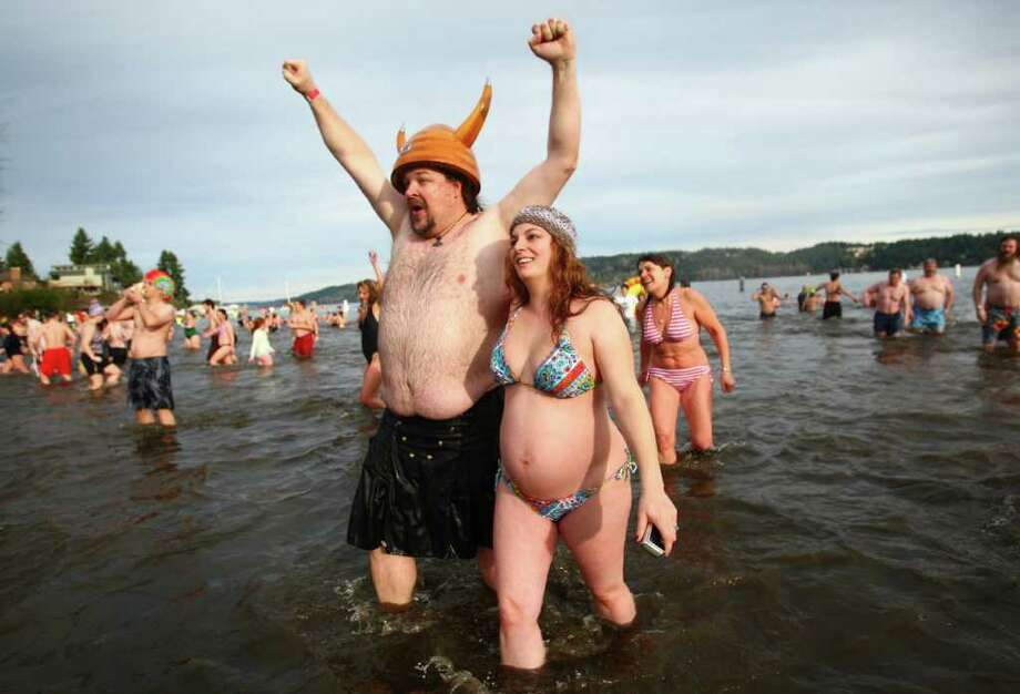 Participants brave the 49-degree Lake Washington water during the annual Polar Bear Plunge at Matthews Beach in Seattle. Photo: JOSHUA TRUJILLO / SEATTLEPI.COM