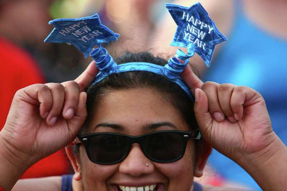 Kavitha Chunchu shows her New Years headband as participants prepare to brave the 49-degree Lake Washington water during the annual Polar Bear Plunge at Matthews Beach in Seattle. Photo: JOSHUA TRUJILLO / SEATTLEPI.COM