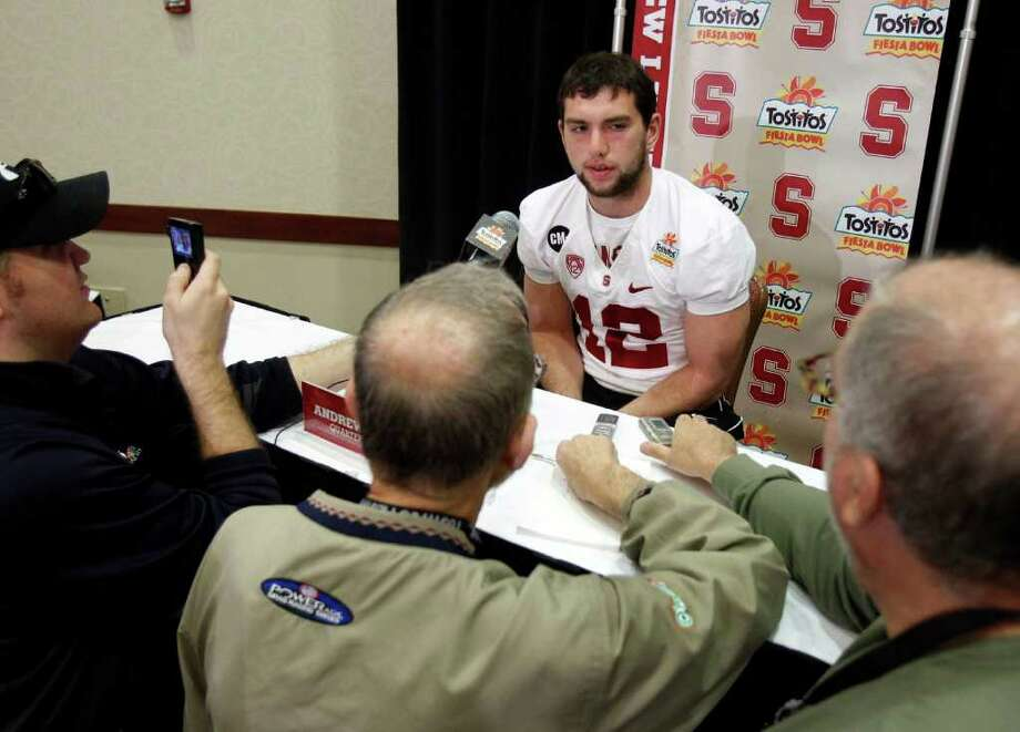 Stanford quarterback Andrew Luck answers reporters' questions during media day for the Fiesta Bowl Friday, Dec. 30, 2011, in Scottsdale, Ariz. Stanford is scheduled to play Oklahoma State in the Fiesta Bowl college football game on Jan. 2. Photo: AP
