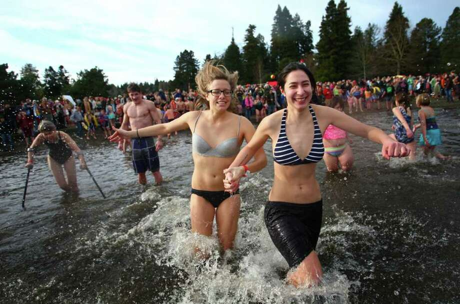 Participants run into Lake Washington during the annual Polar Bear Plunge at Matthews Beach in Seattle. Photo: JOSHUA TRUJILLO / SEATTLEPI.COM