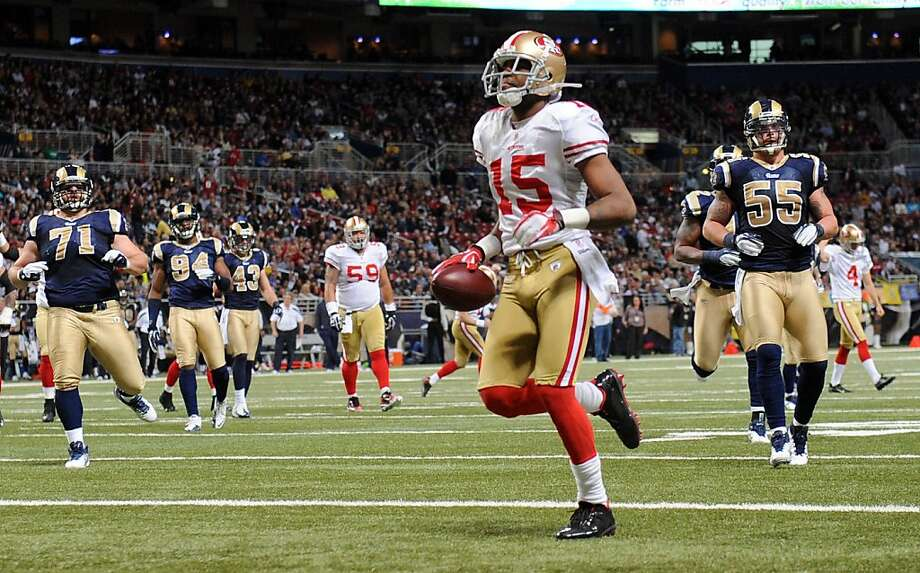 San Francisco 49ers wide receiver Michael Crabtree jogs into the end zone for a touchdown after catching a pass from 49ers kicker David Akers on a fake field goal attempt during the third quarter of an NFL football game against the St. Louis Rams Sunday, Jan. 1, 2012, in St. Louis. (AP Photo/L.G. Patterson) Photo: L.G. Patterson, Associated Press
