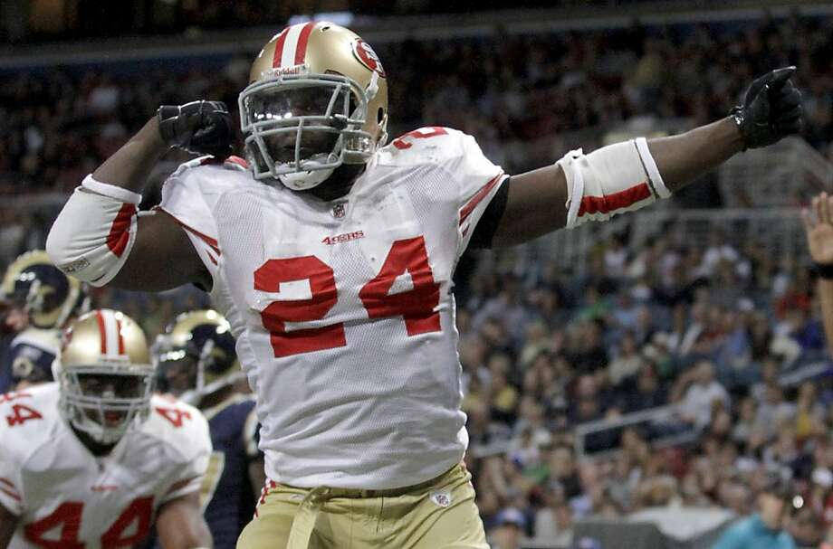 San Francisco 49ers running back Anthony Dixon celebrates after running for a 1-yard touchdown during the fourth quarter of an NFL football game Sunday, Jan. 1, 2012, in St. Louis. (AP Photo/Seth Perlman) Photo: Seth Perlman, Associated Press