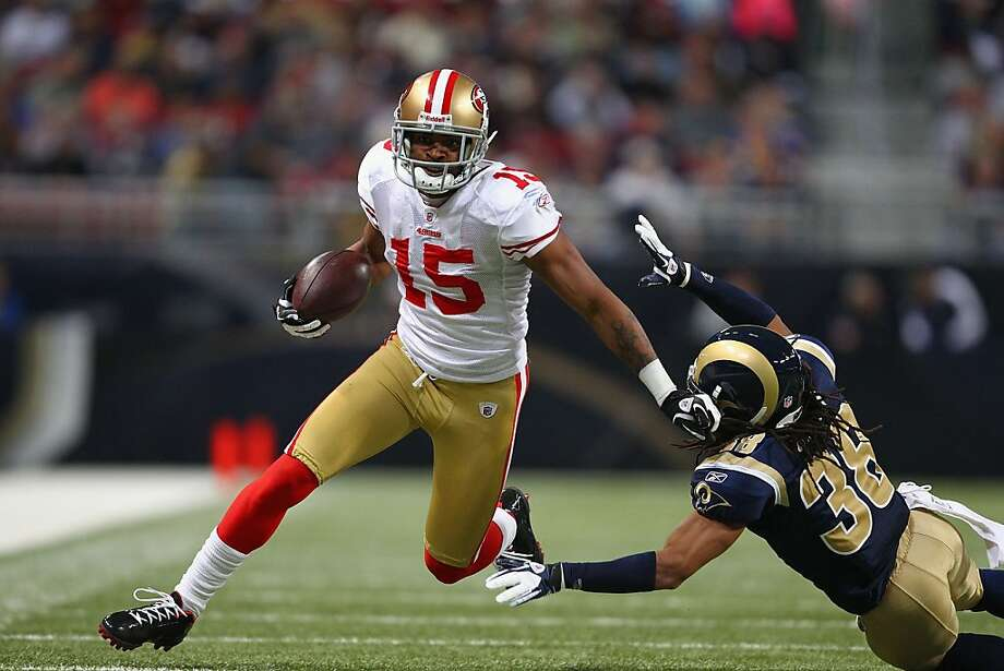 ST. LOUIS, MO - JANUARY 1: Michael Crabtree #15 of the San Francisco 49ers gets past Josh Gordy #38 of the St. Louis Rams on his way to a touchdown at the Edward Jones Dome on January 1, 2012 in St. Louis, Missouri.  The 49ers beat the Rams 34-27.  (Photo by Dilip Vishwanat/Getty Images) Photo: Dilip Vishwanat, Getty Images