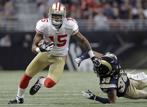 San Francisco 49ers wide receiver Michael Crabtree, left, runs past St. Louis Rams defensive back Josh Gordy on a 28-yard touchdown during the second quarter of an NFL football game Sunday, Jan. 1, 2012, in St. Louis. (AP Photo/Seth Perlman) Photo: Seth Perlman, Associated Press