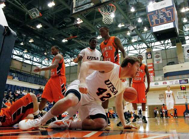 UTSA's Tyler Wood (42) reacts after scoring on a foul against Bowling Green in men's basketball at UTSA on Sunday, Jan. 1, 2012. UTSA won 86-79 in overtime. Photo: KIN MAN HUI, ~ / SAN ANTONIO EXPRESS-NEWS
