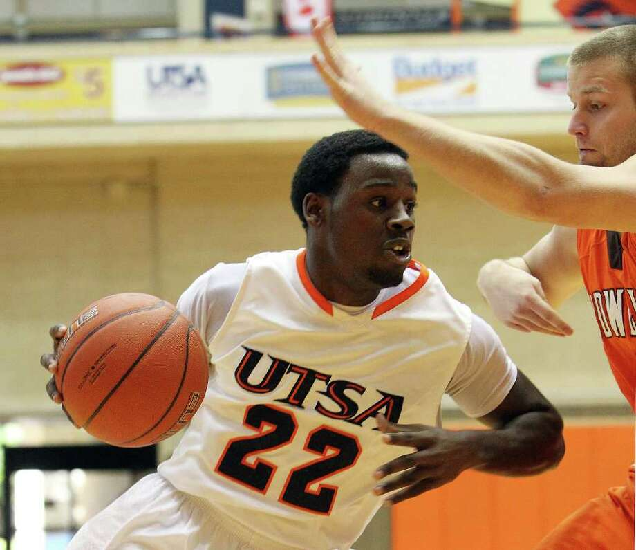 UTSA's Kannon Burrage (22) pushes away Bowling Green's Luke Kraus (03) in men's basketball at UTSA on Sunday, Jan. 1, 2012. UTSA won 86-79 in overtime. Photo: KIN MAN HUI, ~ / SAN ANTONIO EXPRESS-NEWS