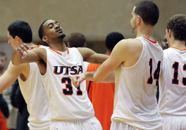 UTSA's Melvin Johnson, III (31) gets a chest bump from teammate Alex Vouyoukas (14) after the Roadrunners defeated Bowling Green in overtime in men's basketball at UTSA on Sunday, Jan. 1, 2012. UTSA won 86-79 in overtime. Photo: KIN MAN HUI, ~ / SAN ANTONIO EXPRESS-NEWS