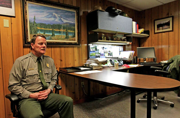 Superintendent of Mount Rainier National Park Randy King talks about Margaret Anderson, a law enforcement ranger at the park that was shot and killed on New Years Day, Sunday, Jan. 1, 2012, sparking the closure of the park and a massive manhunt for the suspect, in Mount Rainier Nation Park, Wash. (AP Photo/The News Tribune, Dean J. Koepfler)