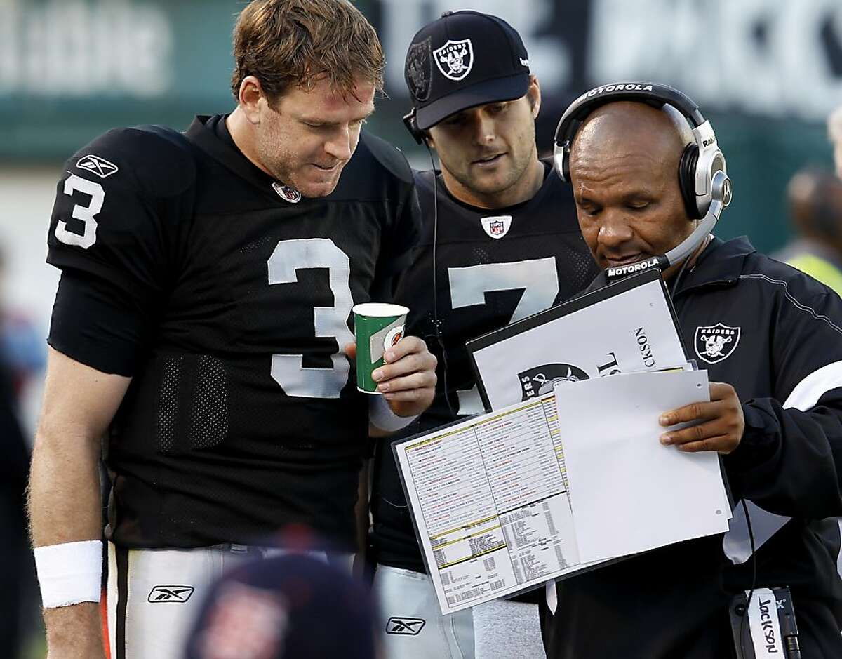 Raiders head coach Hue Jackson (right) talked over the game plan early in the second half with Carson Palmer. The Oakland Raiders lost their last regular season game to the San Diego Chargers 38-26 Sunday January 1, 2012 at O.co stadium.