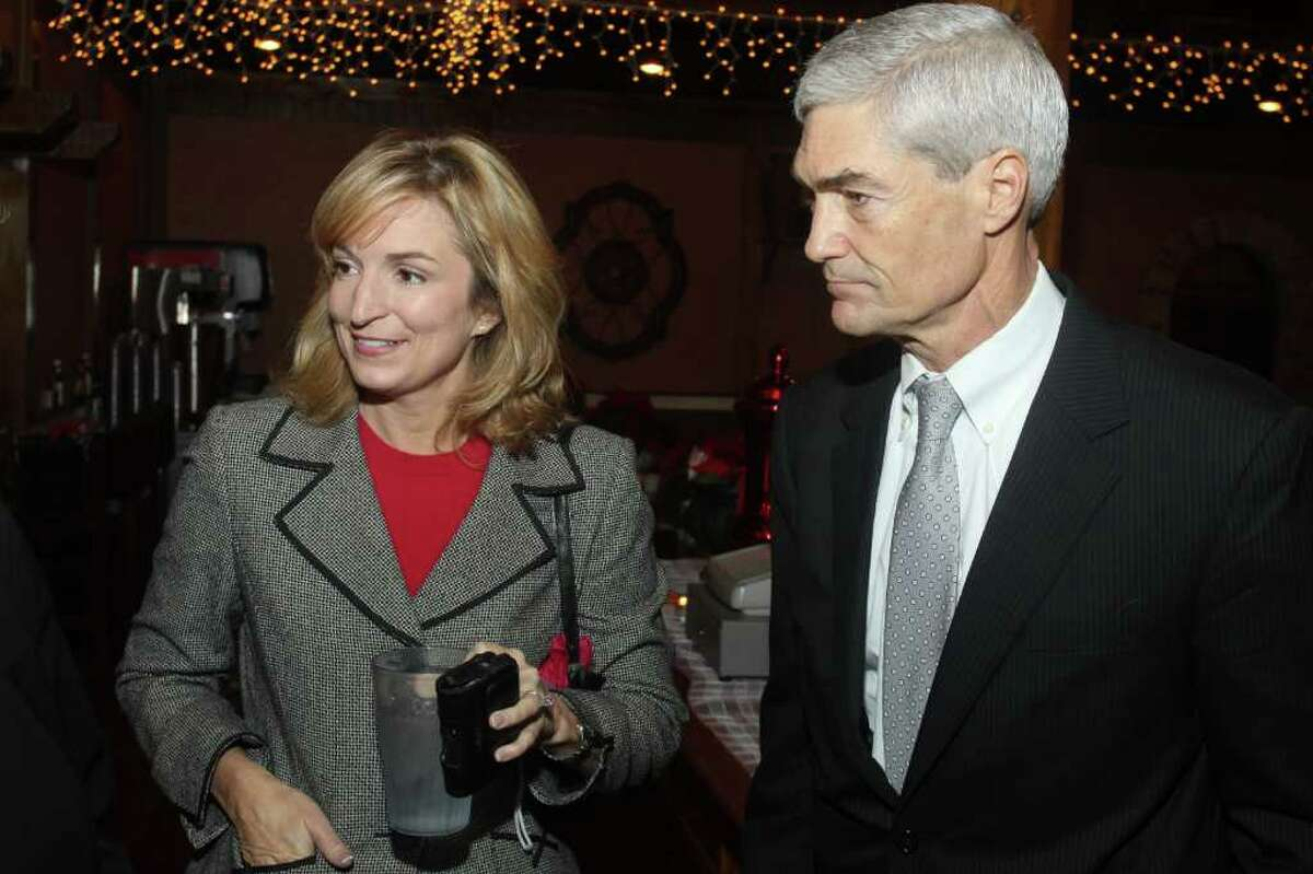 Judge Mike Anderson, shown with his wife, Devon, shocked GOP officials by filing to run against Lykos in the primary election.