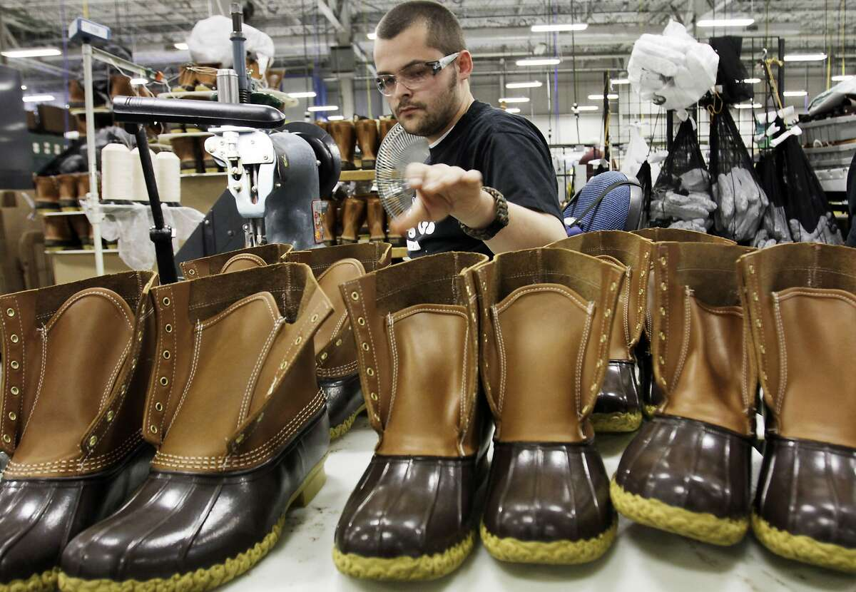 In this Dec. 14, 2011 photo, Eric Rego, of E. Boothbay, Maine, stitches boots in the facility where L.L. Bean boots are assembled in Brunswick, Maine. L.L. Bean's famed hunting boots are seeing a surge in popularity, necessitating the hiring of more than 100 additional employees to make them. (AP Photo/Pat Wellenbach)