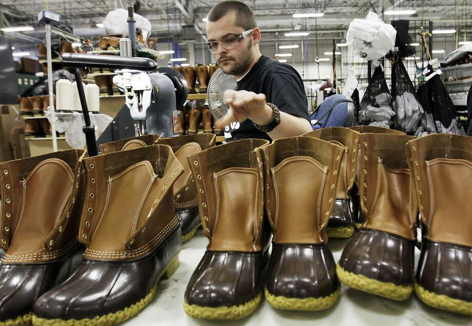In this Dec. 14,  2011 photo, Eric Rego, of E. Boothbay, Maine, stitches boots in the facility where L.L. Bean boots are assembled in Brunswick, Maine. L.L. Bean's famed hunting boots are seeing a surge in popularity, necessitating the hiring of more than 100 additional employees to make them.  (AP Photo/Pat Wellenbach) Photo: Pat Wellenbach, Associated Press