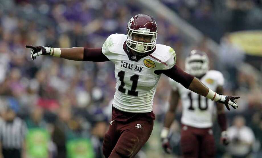 KAREN WARREN: CHRONICLE BUILDING BLOCK: Jonathan Stewart, celebrating a sack Saturday, will be one of the top returnees on an A&M defense that will need to improve as the Aggies embark on SEC play. Photo: Karen Warren / © 2011 Houston Chronicle