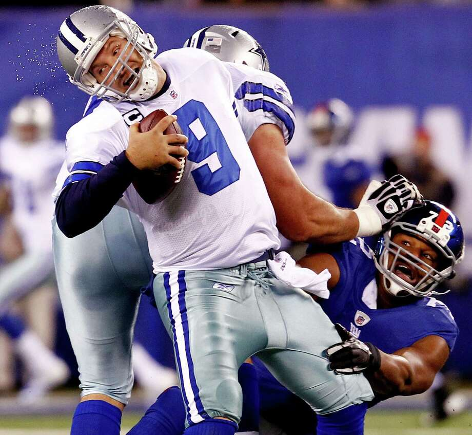 Osi Umenyiora (right) and the Giants dominated Tony Romo and the Cowboys 31-14 on New Year's Day in the 2011 regular-season finale. The victory propelled the Giants to their second Super Bowl victory in four years. Photo: Jeff Zelevansky, Getty Images / 2012 Getty Images