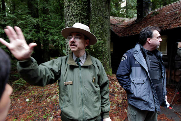 National Parks spokesman Kevin Bacher, left, and Pierce County Sheriff's Dept. spokesman and detective Ed Troyer, right, talk to reporters outside an an entrance to Mount Rainier National Park, Sunday, Jan. 1, 2012 in Washington State. Park rangers were turning away incoming visitors after a National Parks Service Ranger was shot and killed at the park Sunday morning. (AP Photo/Ted S. Warren) / AP2012