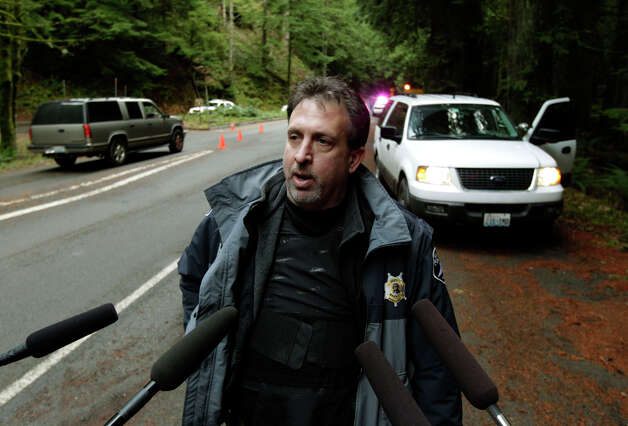 Pierce County Sheriff's Dept. spokesman and detective Ed Troyer talks to reporters outside an an entrance to Mount Rainier National Park, Sunday, Jan. 1, 2012 in Washington State. Park rangers were turning away incoming visitors after a National Parks Service Ranger was shot and killed at the park Sunday morning. (AP Photo/Ted S. Warren)
