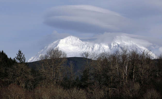 Mount Rainier is shown near Ashford, Wash., Sunday, Jan. 1, 2012. Mount Rainier National Park was closed Sunday, after a National Parks Service Ranger was shot and killed Sunday morning and officials searched for the gunman. (AP Photo/Ted S. Warren)