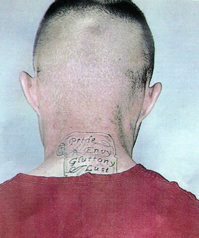 "In this photo provided by the Pierce County Sheriff's Dept., Benjamin Colton Barnes, is shown with a tattoo that reads ""Pride, Envy, Gluttony, Lust."" Officials said Barnes is a person of interest in the fatal shooting of a park ranger at Mount Rainier National Park, Sunday, Jan. 1, 2012 in Washington State. (AP Photo/Pierce County Sheriff's Dept.) / AP2012"