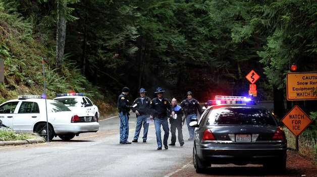 Washington State Patrol troopers staff a roadblock at an entrance to Mount Rainier National Park, Sunday, Jan. 1, 2012 in Washington State. Park rangers were turning away incoming visitors after a National Parks Service Ranger was shot and killed at the park Sunday morning and officials searched for the gunman. (AP Photo/Ted S. Warren) / AP2012