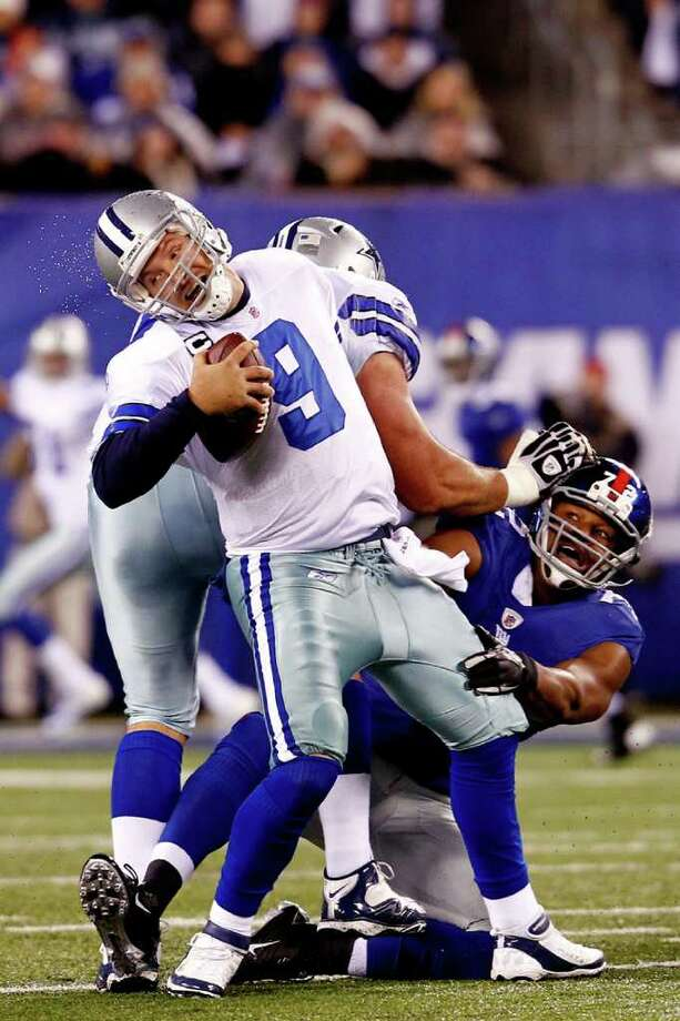 The Giants' Osi Umenyiora attempts to tackle the Cowboys' Tony Romo at MetLife Stadium on Sunday, Jan. 1, 2012 in East Rutherford, N.J. Photo: Jeff Zelevansky, Jeff Zelevansky, Getty Images / 2012 Getty Images