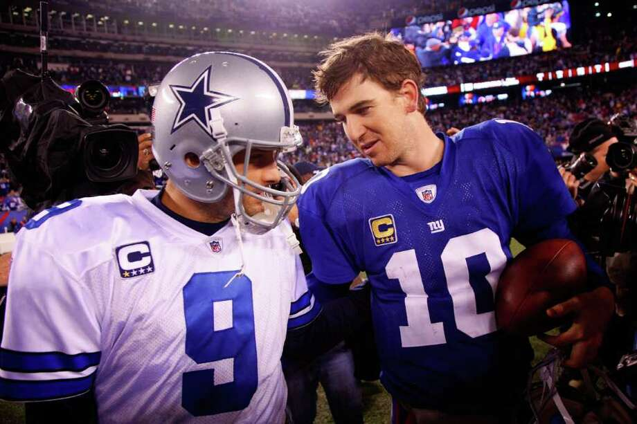 Cowboys quarterback Tony Romo and Giants quarterback Eli Manning greet each other after their game at MetLife Stadium on Sunday, Jan. 1, 2012 in East Rutherford, N.J. Photo: Jeff Zelevansky, Jeff Zelevansky, Getty Images / 2012 Getty Images