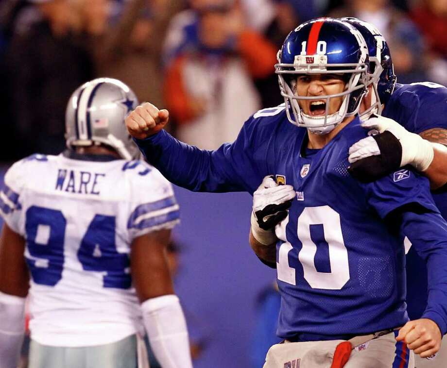 The Giants' Eli Manning and David Diehl celebrate after a passing touchdown in the fourth quarter at MetLife Stadium on Sunday, Jan. 1, 2012 in East Rutherford, N.J. Photo: Jeff Zelevansky, Jeff Zelevansky, Getty Images / 2012 Getty Images