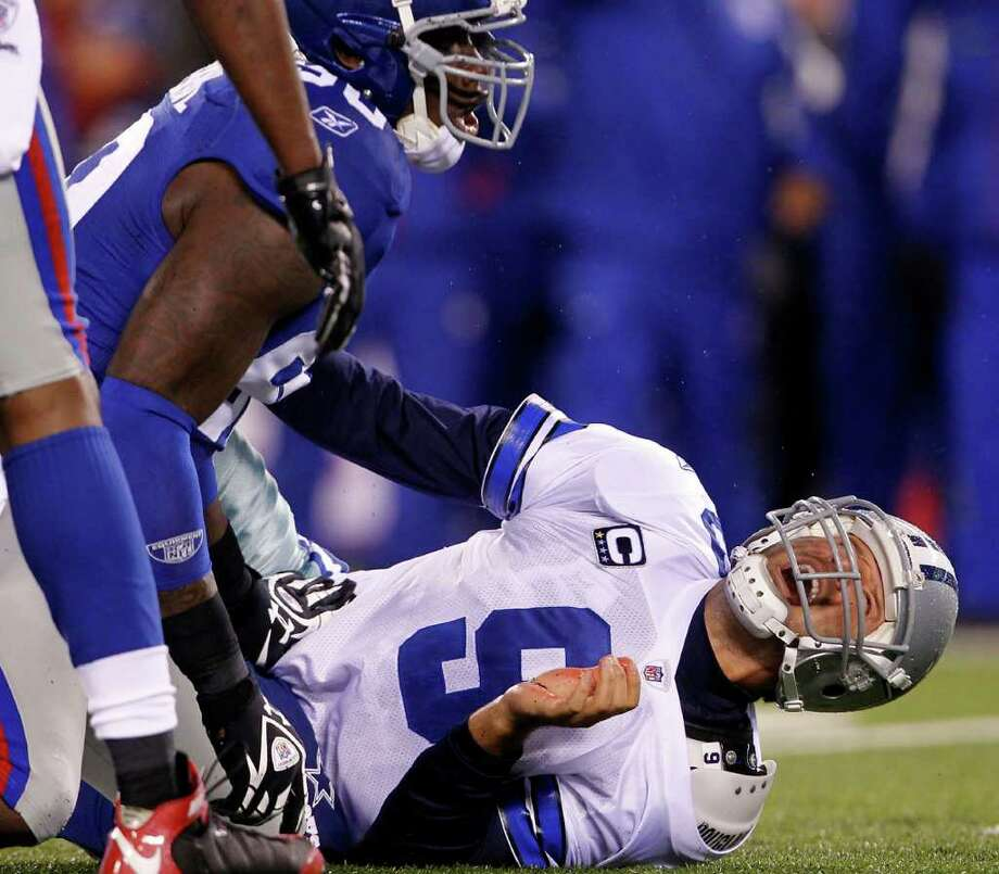The Giants' Jason Pierre-Paul sacks Cowboys quarterback Tony Romo in the first quarter at MetLife Stadium on Sunday, Jan. 1, 2012 in East Rutherford, N.J. Photo: Rich Schultz, Rich Schultz, Getty Images / 2012 Getty Images