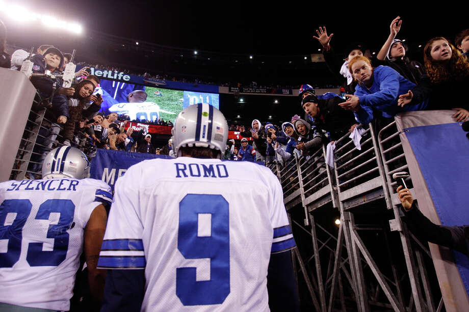 Cowboys quarterback Tony Romo walks off of the field after losing against the Giants at MetLife Stadium on Sunday, Jan. 1, 2012 in East Rutherford, N.J. Photo: Rich Schultz, Rich Schultz, Getty Images / 2012 Getty Images