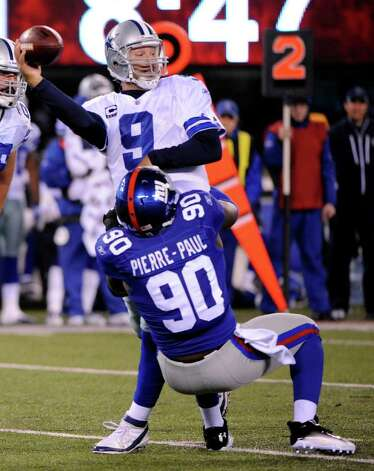 New York Giants defensive end Jason Pierre-Paul sacks Dallas Cowboys quarterback Tony Romo during the first half of an NFL football game Sunday, Jan. 1, 2012, in East Rutherford, N.J. Photo: Bill Kostroun, Associated Press