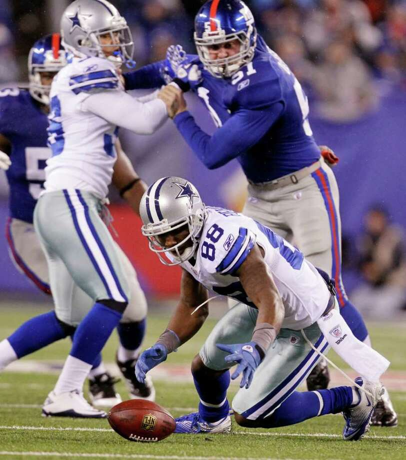 Dallas Cowboys wide receiver Dez Bryant (88) jumps on a loose ball after dropping a punt return against the New York Giants during the first half of an NFL football game Sunday, Jan. 1, 2012, in East Rutherford, N.J. Photo: Julio Cortez, Associated Press