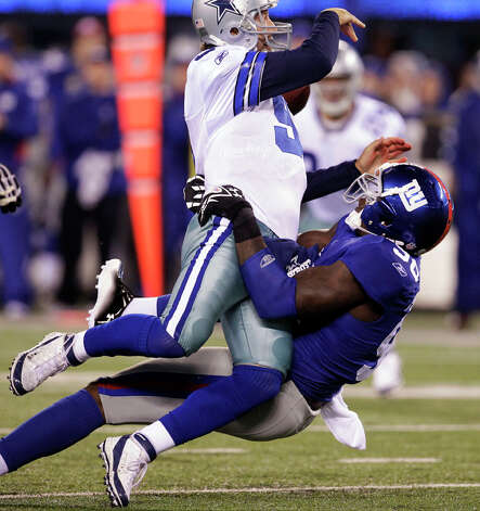 New York Giants defensive end Jason Pierre-Paul sacks Dallas Cowboys quarterback Tony Romo during the first half of an NFL game Sunday, Jan. 1, 2012, in East Rutherford, N.J. Photo: Julio Cortez, Julio Cortez, Associated Press / AP