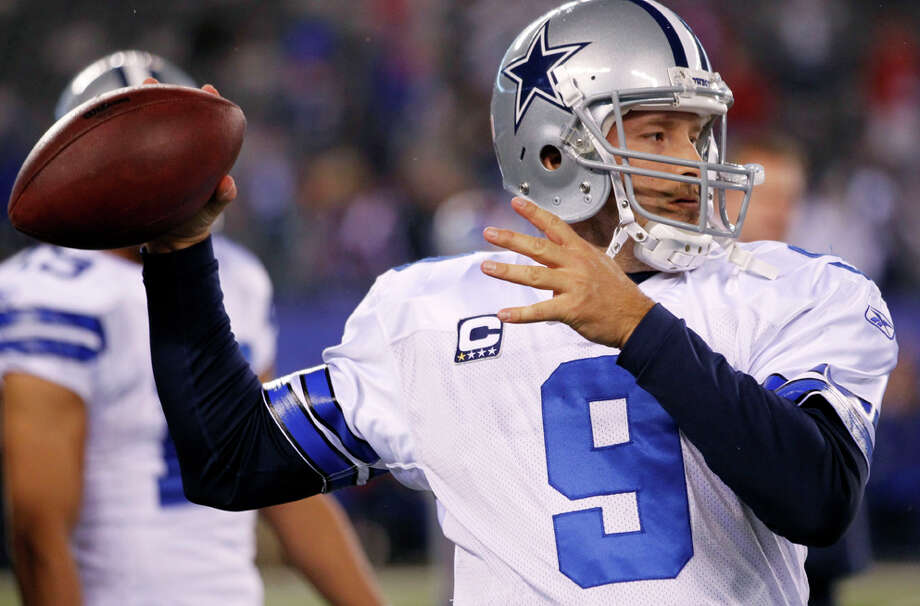 Dallas Cowboys quarterback Tony Romo warms up before an NFL game against the New York Giants Sunday, Jan. 1, 2012, in East Rutherford, N.J. Photo: Julio Cortez, Julio Cortez, Associated Press / AP