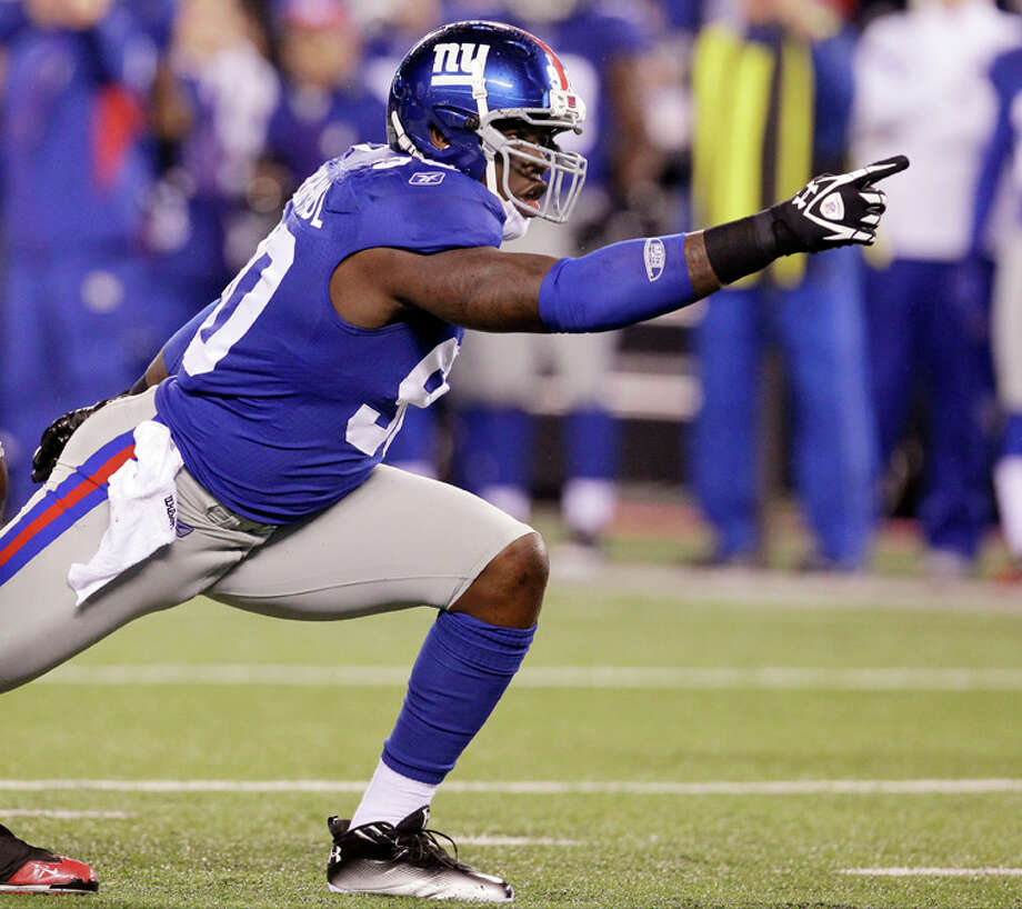 New York Giants defensive end Jason Pierre-Paul celebrates after sacking Dallas Cowboys quarterback Tony Romo during the first half of an NFL game Sunday, Jan. 1, 2012, in East Rutherford, N.J. Photo: Julio Cortez, Julio Cortez, Associated Press / AP