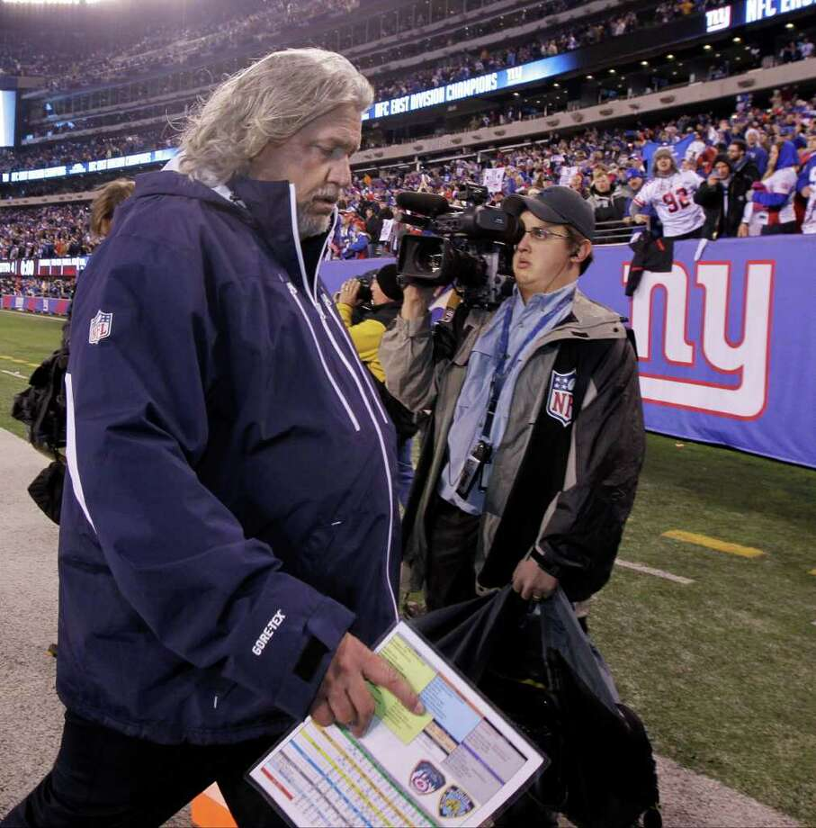 Dallas Cowboys defensive coordinator Rob Ryan walks off the field following their NFL football game against the New York Giants Sunday, Jan. 1, 2012, in East Rutherford, N.J. The Giants defeated the Cowboys 31-14. Photo: Julio Cortez, Associated Press