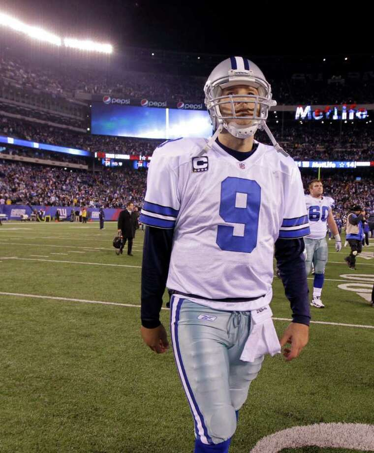 Dallas Cowboys quarterback Tony Romo walks off the field following their NFL football game against the New York Giants Sunday, Jan. 1, 2012, in East Rutherford, N.J. The Giants defeated the Cowboys 31-14. Photo: Julio Cortez, Associated Press