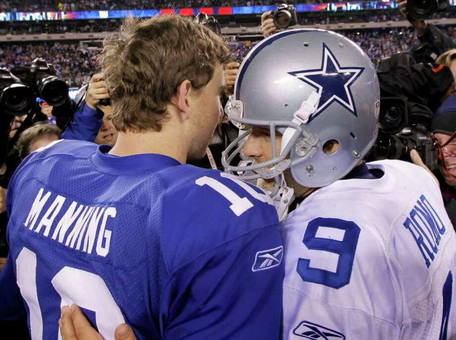 Dallas Cowboys quarterback Tony Romo (9) chats with New York Giants quarterback Eli Manning after their NFL football game Sunday, Jan. 1, 2012, in East Rutherford, N.J. The Giants defeated the Cowboys 31-14. Photo: Julio Cortez, Associated Press