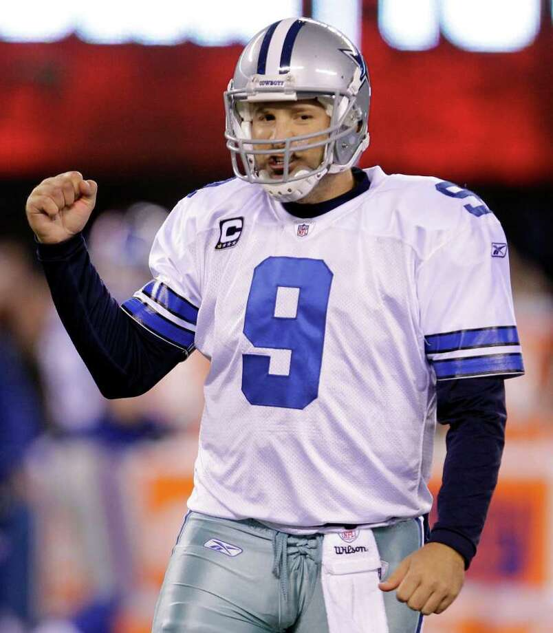 Dallas Cowboys quarterback Tony Romo celebrates after a 34-yard touchdown pass to Laurent Robinson during the second half of an NFL football game against the New York Giants Sunday, Jan. 1, 2012, in East Rutherford, N.J. Photo: Julio Cortez, Associated Press