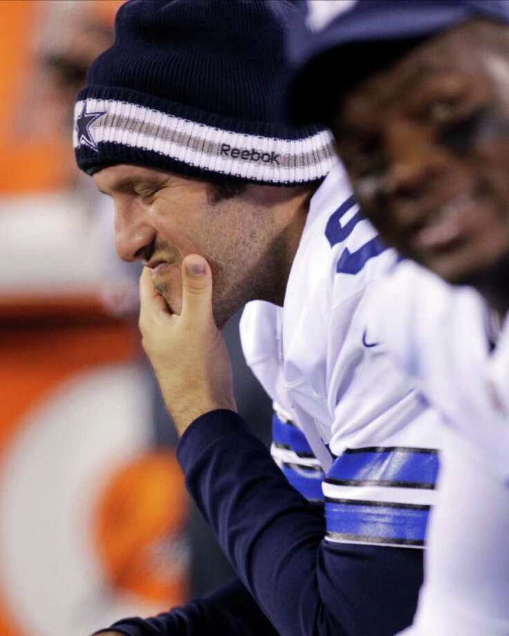 Dallas Cowboys quarterback Tony Romo, left, sits on the bench during the first half of an NFL football game against the New York Giants Sunday, Jan. 1, 2012, in East Rutherford, N.J. Photo: Julio Cortez, Associated Press