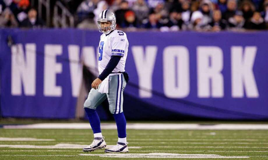 Dallas Cowboys quarterback Tony Romo (9) walks off the field during the first half of an NFL football game against the New York Giants Sunday, Jan. 1, 2012, in East Rutherford, N.J. Photo: Julio Cortez, Associated Press