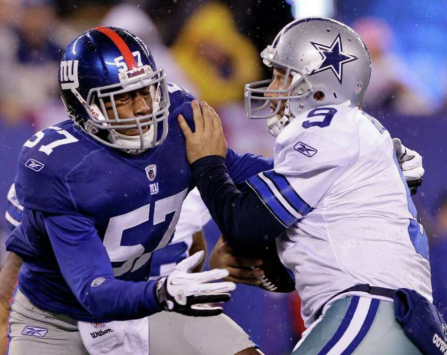 Jacquian Williams and the Giants defense manhandled the Cowboys and Tony Romo in last season's 31-14 finale. Photo: Kathy Willens, Associated Press