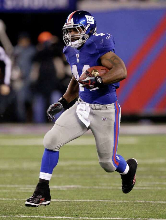 New York Giants running back Ahmad Bradshaw (44) rushes against the Dallas Cowboys during the first half of an NFL football game Sunday, Jan. 1, 2012, in East Rutherford, N.J. Photo: Kathy Willens, Associated Press