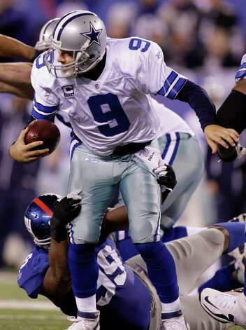 Dallas Cowboys quarterback Tony Romo (9) is sacked by New York Giants defensive tackle Chris Canty (99) during the second half of an NFL football game Sunday, Jan. 1, 2012, in East Rutherford, N.J. The Cowboys lost the game 31-14. Photo: Kathy Willens,  Associated Press