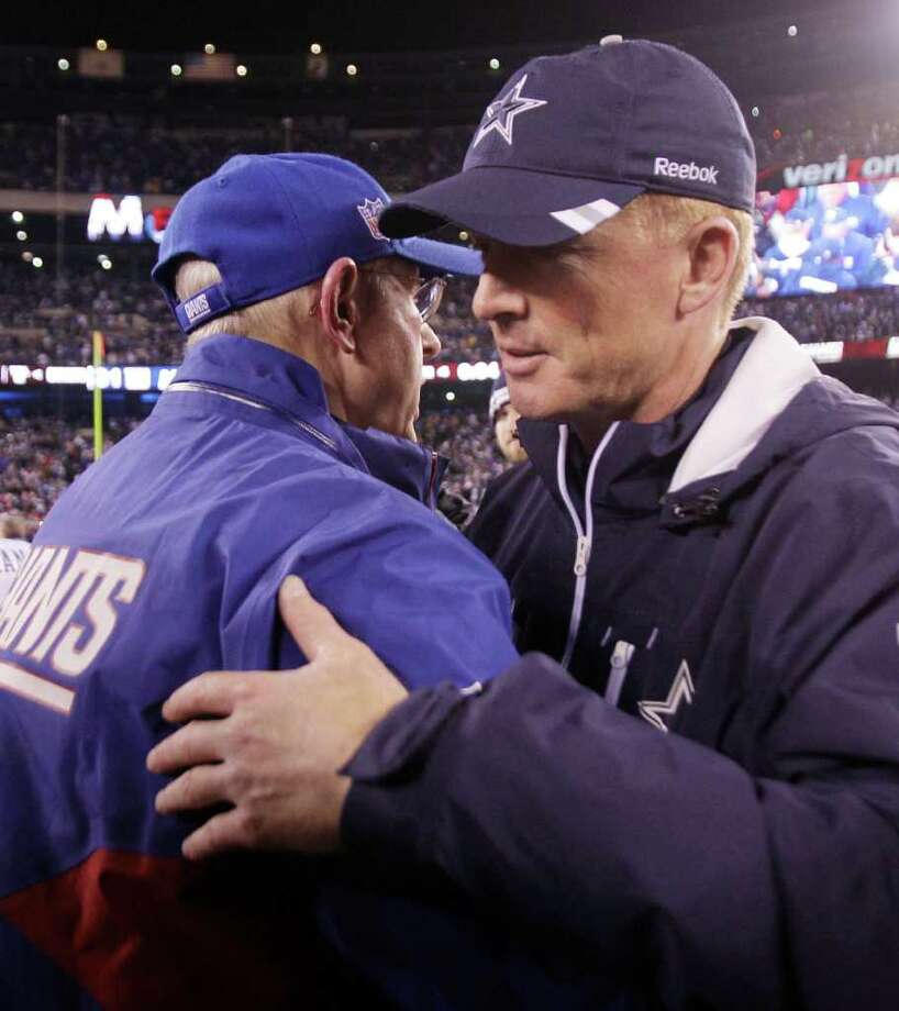 New York Giants head coach Tom Coughlin, left, is congratulated by Dallas Cowboys head coach Jason Garrett following their NFL football game Sunday, Jan. 1, 2012, in East Rutherford, N.J. The Giants defeated the Cowboys 31-14. Photo: Kathy Willens, Associated Press