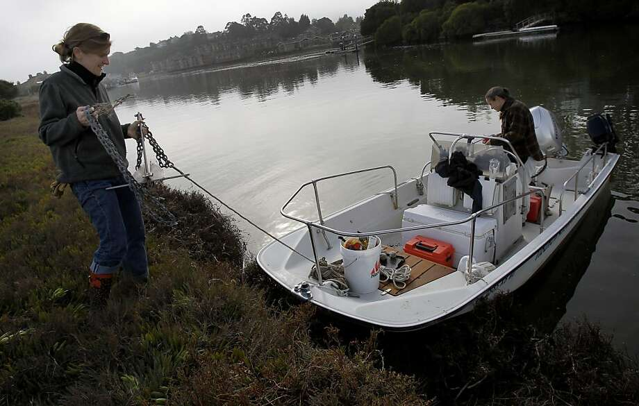 Brooke Langston (left), center director, and Lara Martin, a research technician dock their Boston Whaler on the island. Aramburu Island, a small man made island near Tiburon, Calif. is being transformed into a living ecosystem by the Richardson Bay Audubon  Center and Sanctuary. Photo: Brant Ward, The Chronicle