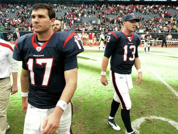 Houston Texans quarterbacks  Jake Delhomme (17) and  T.J. Yates (13) leave the field after a 23-22 loss to the Tennessee Titans in an NFL football game on Sunday, Jan. 1, 2012, in Houston. The Titans defeated the Texans 23-22. Photo: Dave Einsel, Associated Press