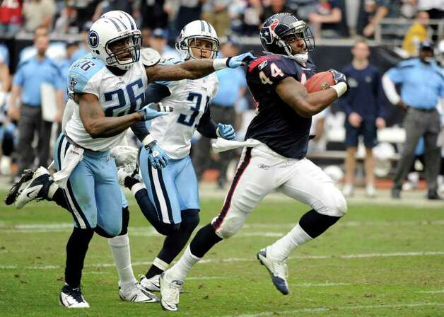 Tennessee Titans strong safety Jordan Babineaux (26) grabs Houston Texans running back Ben Tate (44) as Titans' Cortland Finnegan (31) follows in the third quarter of an NFL football game on Sunday, Jan. 1, 2012, in Houston. Photo: Dave Einsel, Associated Press