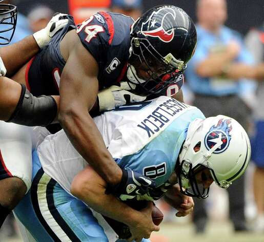 Houston Texans defensive end Antonio Smith (94) sacks Tennessee Titans quarterback Matt Hasselbeck (8) in the second quarter of an NFL football game on Sunday, Jan. 1, 2012, in Houston. Photo: Dave Einsel, Associated Press